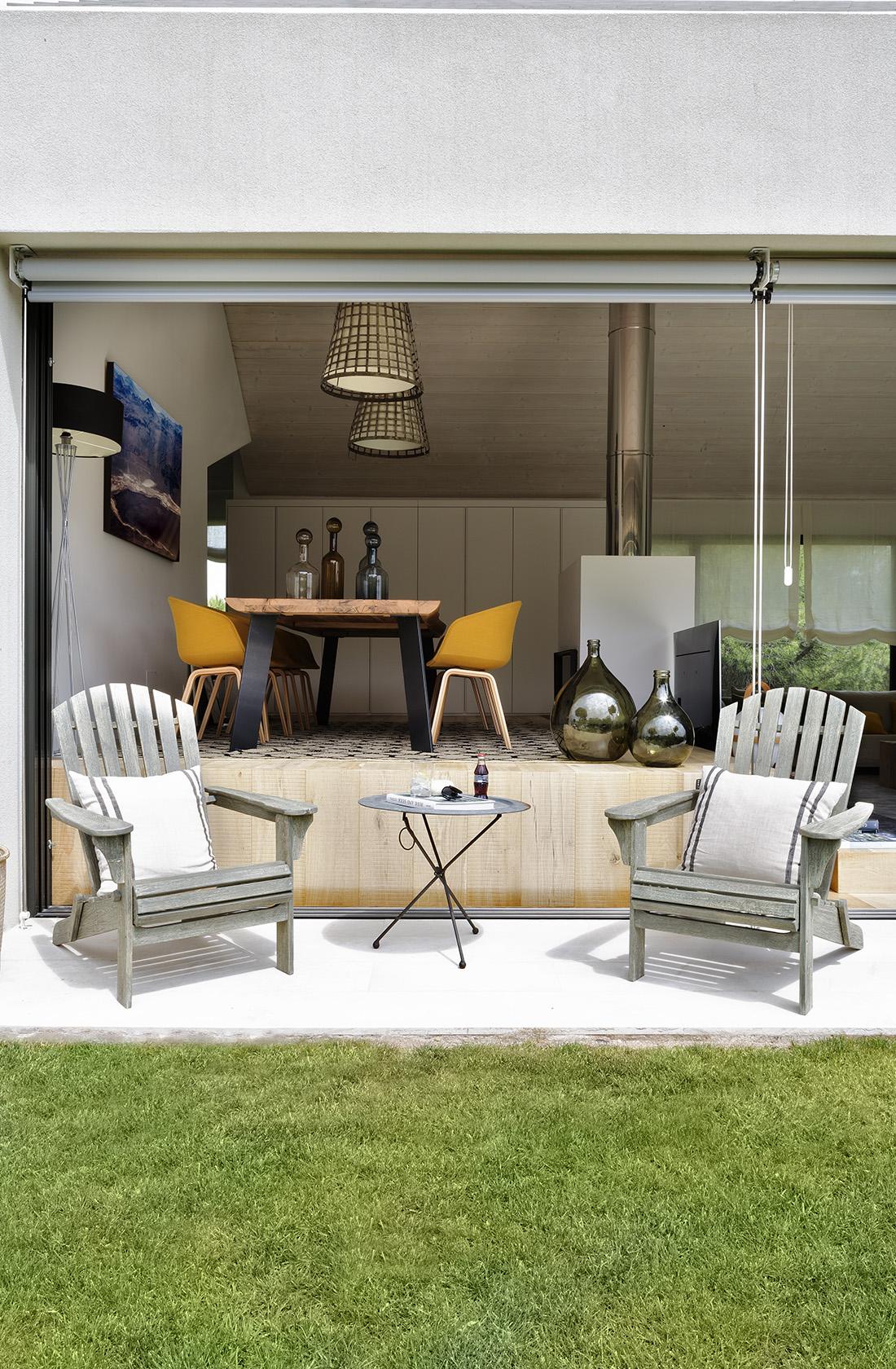 Comedor con acceso al jardín Casa XY, Arquitectura en madera